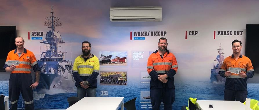 Orontide Leading Hand, Kydon, receives his Safety Recognition Award from BAE Systems and Naval Ship Management (Australia)